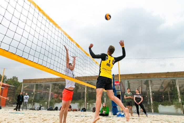 Men playing beach volleyball